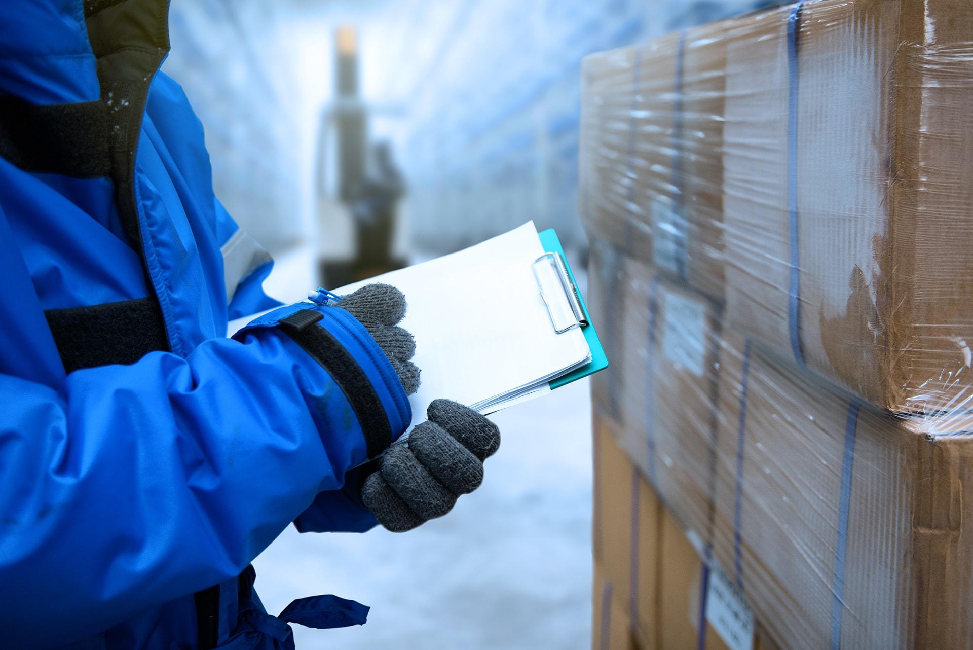 Driver checks out frigo cargo manifest