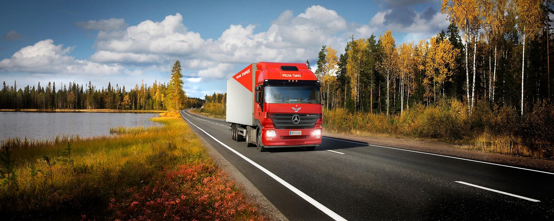 Peura-Trans truck on a small finnish road